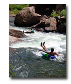 Tubers run the rapids on the North Fork of the Upper South Platte River.